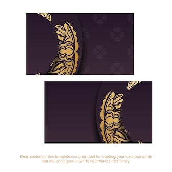 Wizytówka w kolorze bordowym ze złotym ornamentem na kontakty.