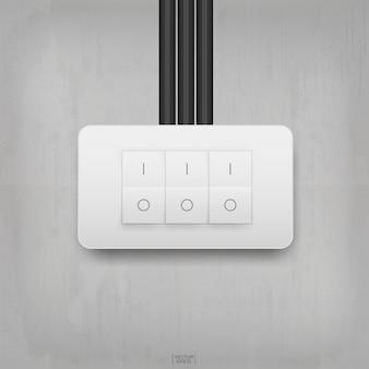 Włącznik światła na tle ściany betonowej