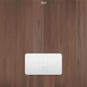 Włącznik światła na tle ściany z drewna