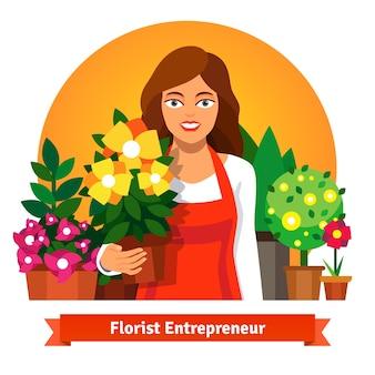 Właściciel firmy kwiaciarnia trzyma doniczkę kwiatów