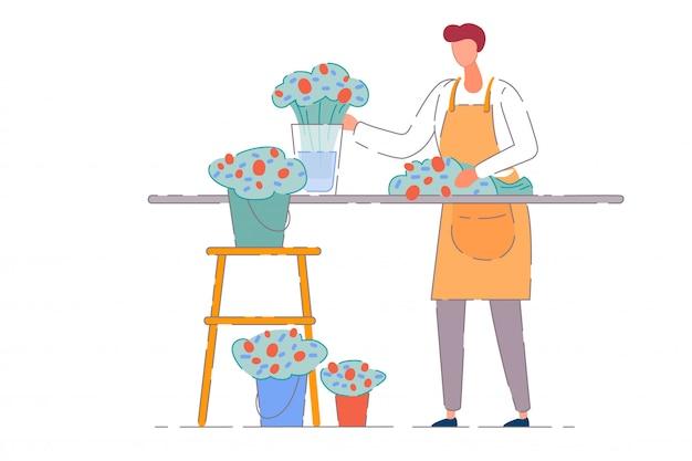Właściciel kwiaciarni. kwiaciarnia sprzedawca mężczyzna w fartuchu pracuje i robi bukiet przy ladzie sklepowej z kwiatami w wiadrach. firma będąca właścicielem sklepu