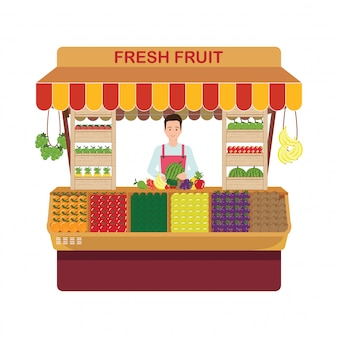 Właściciel sklepu detalicznego owoców i warzyw we własnym sklepie.