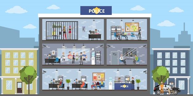 Wnętrze budynku posterunku policji z policjantami i gośćmi.