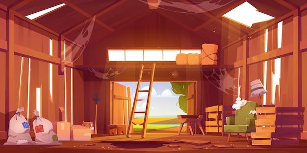 Wnętrze opuszczonej stodoły z połamanymi meblami