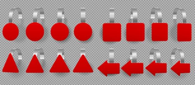 Woblery o różnych kształtach czerwone, metki z ceną