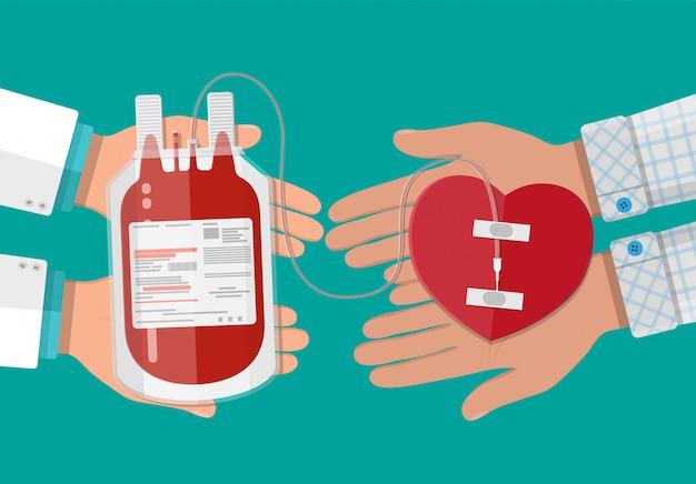 Worek krwi i ręka dawcy z sercem