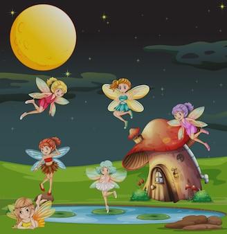 Wróżki latające nad domem w nocy