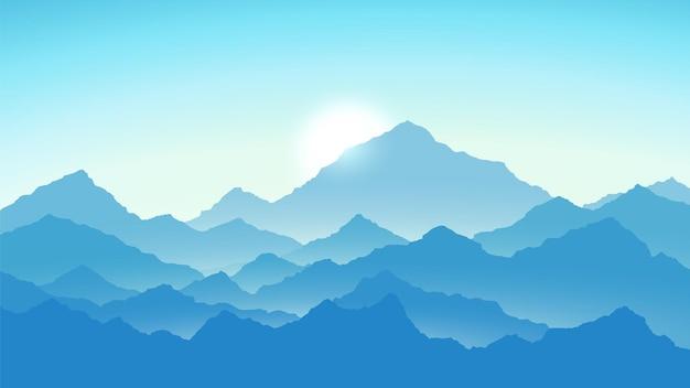 Wschód słońca w górach. widok na góry w kolorach niebieskim