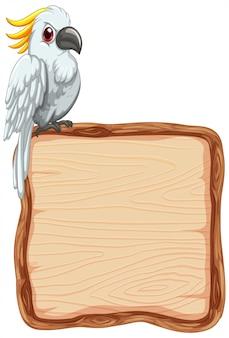 Wsiada szablon z ślicznym kakadu na białym tle