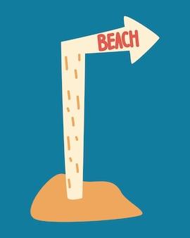 Wskaźnik plaży. drewniana tabliczka na nodze z napisem plaża na wzgórzu z piasku.