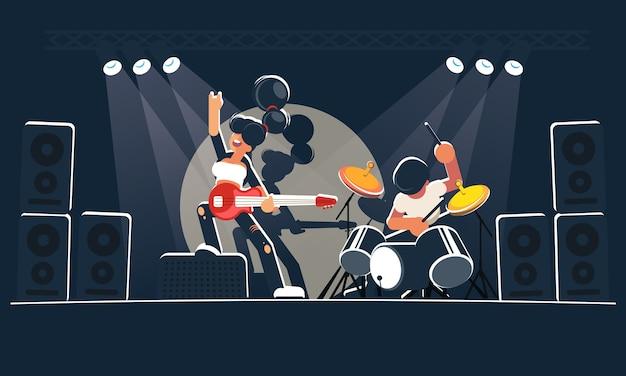 Współczesny zespół muzyczny pokazuje koncert na ciemnej scenie w jasnych promieniach. ładna gitarzystka z czerwoną gitarą elektryczną i szalonym perkusistą grają rock, indie lub alternatywną muzykę instrumentalną.