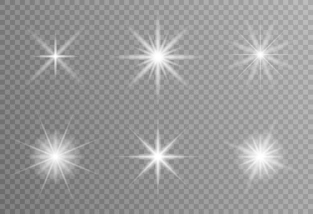 Wybucha białe świecące światło. lśniące cząsteczki pyłu. jasna gwiazda. przezroczyste świecące słońce, jasny błysk. wektor błyszczy. aby wyśrodkować jasny błysk