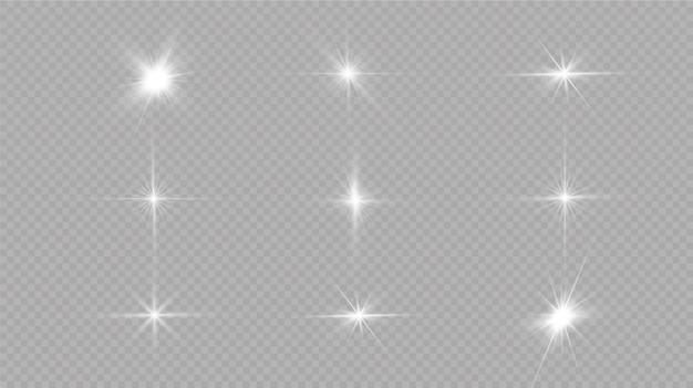 Wybucha białe świecące światło. z promieniem. przezroczyste świecące słońce, jasny błysk. środek jasnego błysku.