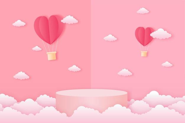 Wyciąć papier szczęśliwy walentynki koncepcja. krajobraz z chmurą, latające balony na gorące powietrze w kształcie serca i podium w kształcie geometrii na stylu sztuki papieru tła różowego nieba.