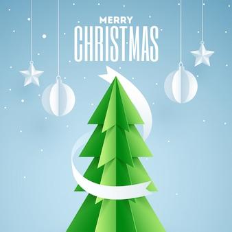 Wycinane z papieru drzewo xmas z wiszącymi bombkami i gwiazdkami ozdobionymi na niebiesko dla świętowania wesołych świąt. kartka z życzeniami