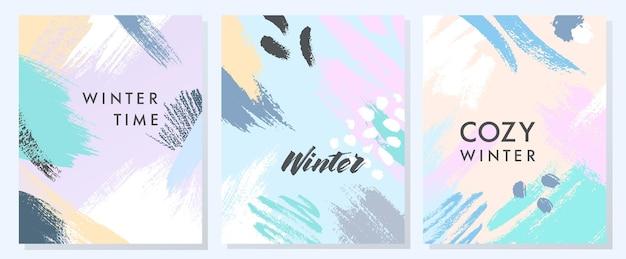 Wyjątkowe artystyczne kartki zimowe z ręcznie rysowanymi kształtami i fakturami w delikatnych pastelowych kolorach. modny projekt graficzny idealny do wydruków, ulotek, banerów, zaproszeń, ofert specjalnych i nie tylko. kolaże wektorowe.