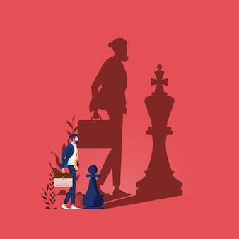 Wymarzony duży biznesmen stojący w cieniu szachowego króla