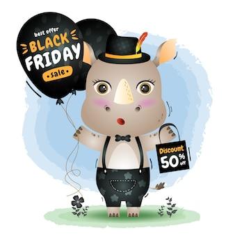 Wyprzedaż w czarny piątek z uroczą promocją balonu nosorożca i ilustracją torby na zakupy