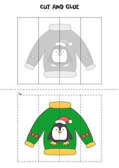 Wytnij i sklej grę dla dzieci. brzydki świąteczny sweterek z pingwinem.