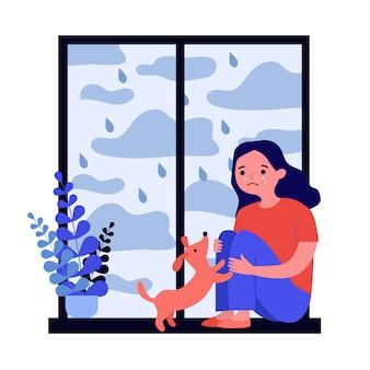 Wzburzona dziewczyna płacze przy okno