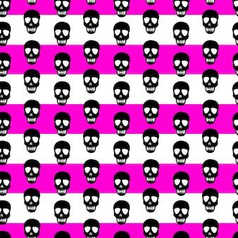 Wzór czaszki na tle w paski