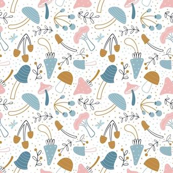 Wzór grzyby. słodkie grzyby w stylu bazgroły na białym tle. paleta pastelowa. jesienny projekt dla tkanin, tekstyliów itp. ilustracja wektorowa