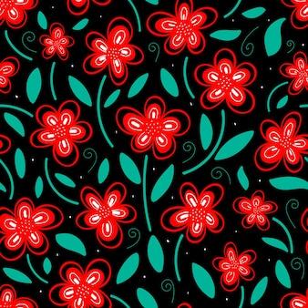 Wzór jasnoczerwonych kwiatów z zielonymi liśćmi na ciemnym tle