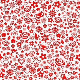 Wzór kwiatów, liści, gwiazd, motyli i serc. czerwony na białym.