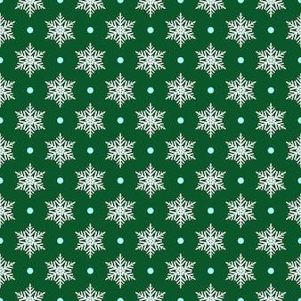 Wzór płatków śniegu i kropek, biały na zielonym