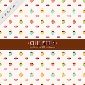 Wzór ręcznie rysowane kolorowe kubki i macarons