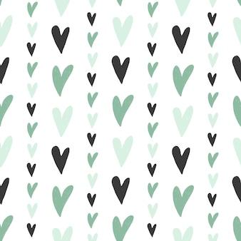 Wzór ręcznie rysowane proste serca w pastelowych kolorach mięty