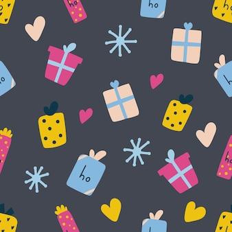 Wzór ręcznie rysowane pudełka na prezenty świąteczne płaska ilustracja na ciemnoniebieskim tle