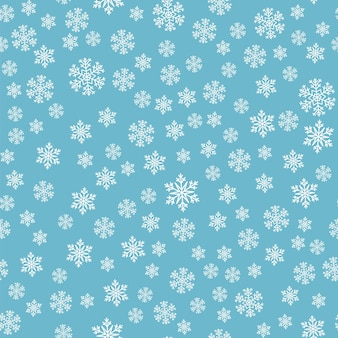 Wzór śniegu. białe płatki śniegu na niebieskim tle. spadający śnieg.