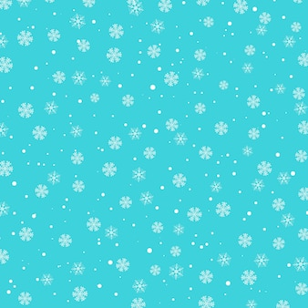 Wzór śniegu. białe płatki śniegu na niebieskim tle.