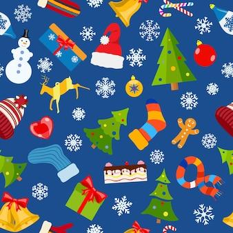 Wzór symboli świątecznych i ciepłych zimowych ubrań w płaski na niebieskim tle