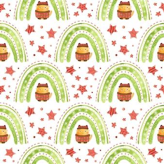 Wzór w bożonarodzeniowe tęczowe gwiazdki i uroczy kotek w zimowej czapce i swetrze holiday