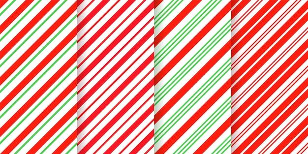 Wzór w paski z trzciny cukrowej. bezszwowe tło boże narodzenie. czerwone, miętowe ukośne linie.