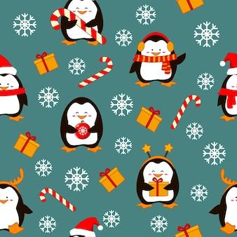 Wzór wesołych świąt z uroczymi pingwinami na śnieżnym tle