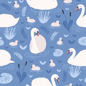 Wzór z białymi łabędziami i potomstwem cygnetów pływających w stawie lub jeziorze wśród lilii wodnych i trzcin