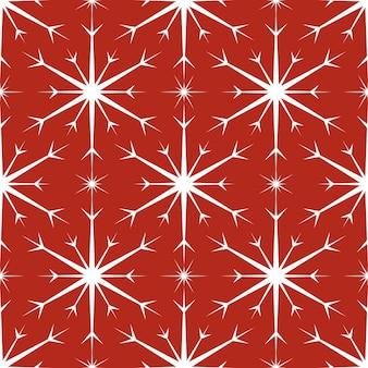 Wzór z białymi płatkami śniegu na czerwonym tle. świąteczna zima tradycyjna dekoracja na nowy rok, boże narodzenie, święta i projekt. ozdoba prostego płatka powtarzającego się płatka śniegu