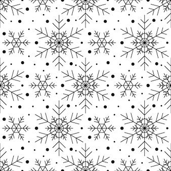 Wzór z czarne płatki śniegu na białym tle. świąteczna zima tradycyjna dekoracja na nowy rok, boże narodzenie, święta i projekt. ozdoba prostego płatka powtarzającego się płatka śniegu