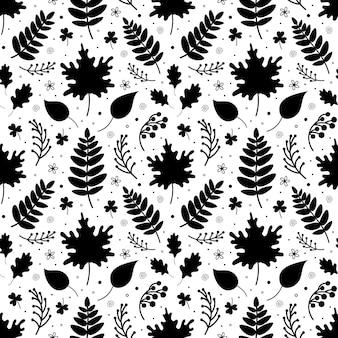 Wzór z czarnymi opadłymi liśćmi gałązek i elementami botanicznymi