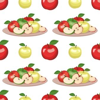 Wzór z czerwonymi i zielonymi jabłkami na talerzu i liściach