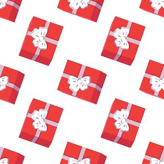 Wzór z czerwonymi pudełkami prezentów na świąteczny nadruk szczęśliwego nowego roku na boże narodzenie i zim...