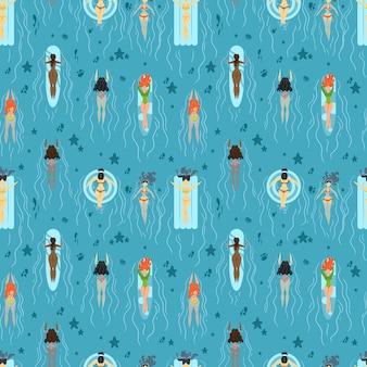 Wzór z dziewczynami pływającymi w morzu.
