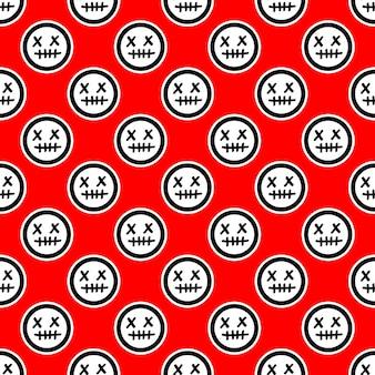 Wzór z emotikonami martwej twarzy na czerwonym tle