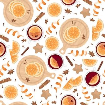 Wzór z grzanym winem, plasterkami pomarańczy, paluszkami cynamonu, goździków i kardamonu. płaskie świeckich bożego narodzenia tło.