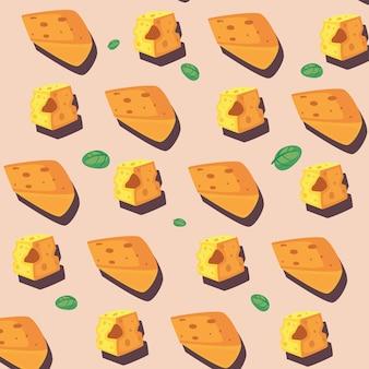 Wzór z kawałkami sera i zielonymi liśćmi