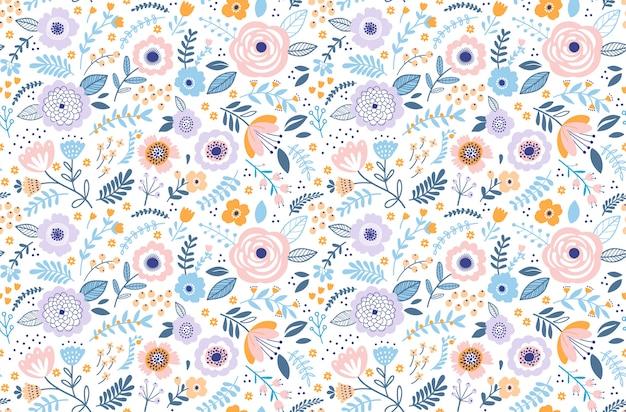 Wzór z kwiatami do projektowania. małe kolorowe kwiaty wielobarwne. biały. nowoczesny kwiatowy.