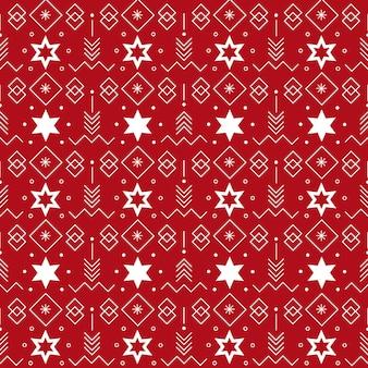 Wzór z powtarzającymi się gwiazdami i elementami geometrycznymi na czerwonym tle na motyw świąteczny de...